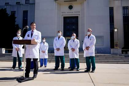 a group of people standing in front of a building: Dr. Sean Conley, physician to President Donald Trump, briefs reporters at Walter Reed National Military Medical Center in Bethesda, Md., Saturday, Oct. 3, 2020. Trump was admitted to the hospital after contracting the coronavirus.